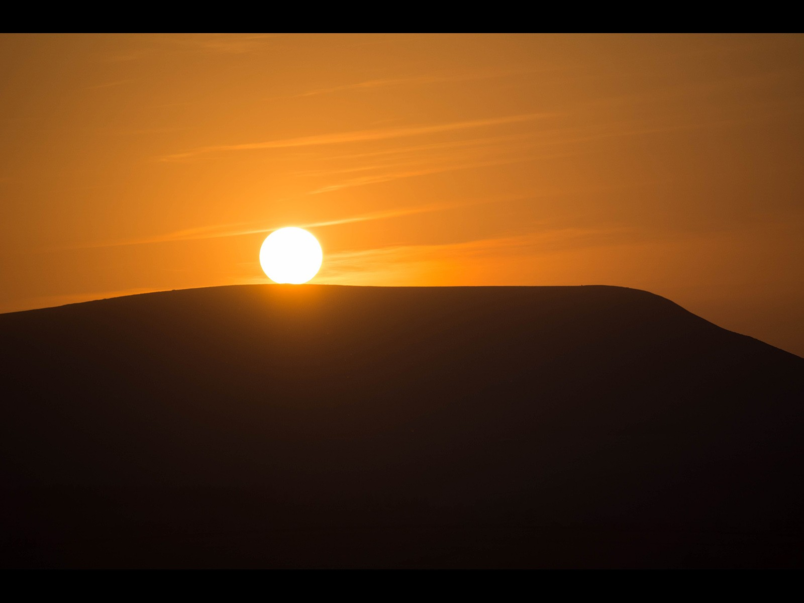 Imagine our Sun rolling down Pendle    Hill