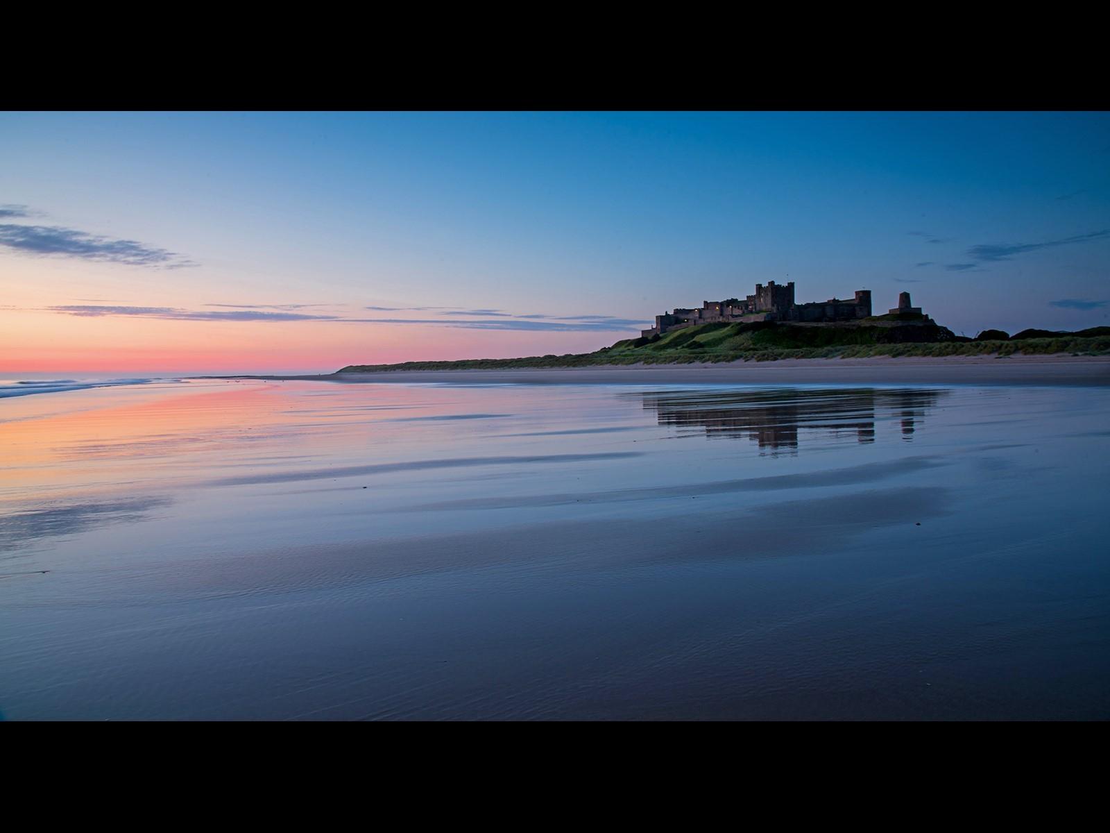 Before dawn Bamburgh beach and Castle