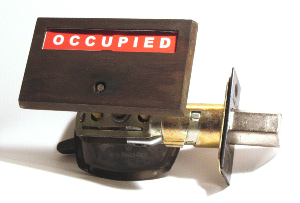 distressed brass indicator bathroom lock