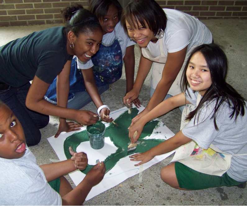 Students collaborating on a painting